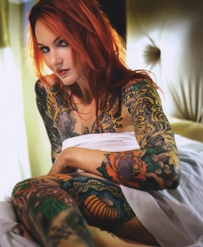 Sexy girl covered legs and hands with tattoo colour.