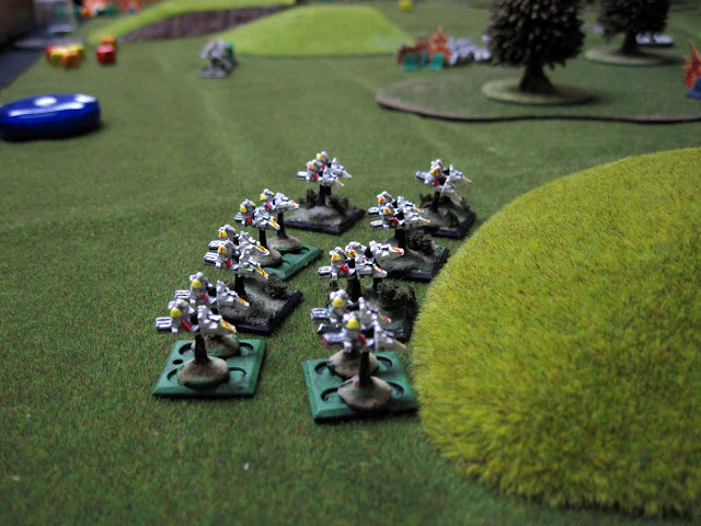 Ed's speeders hiding behind a hill, ready to pounce.