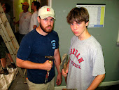 James & Aaron with their hammers ready to smash some drywall.