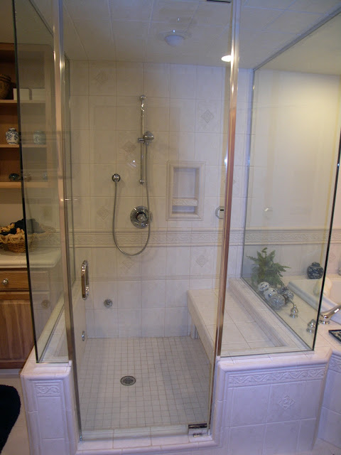 Clear Glass Shower With a Bench