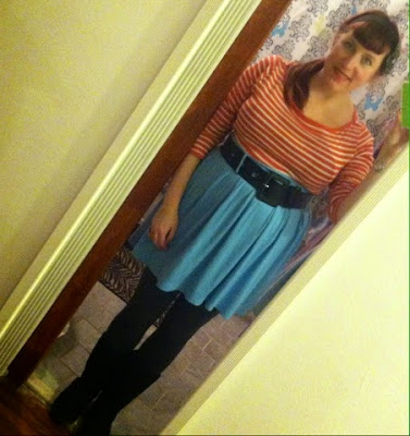 Baby blue swing skirt and orange striped long sleeve shirt plus size outfit using colors on the opposite sides of the color wheel