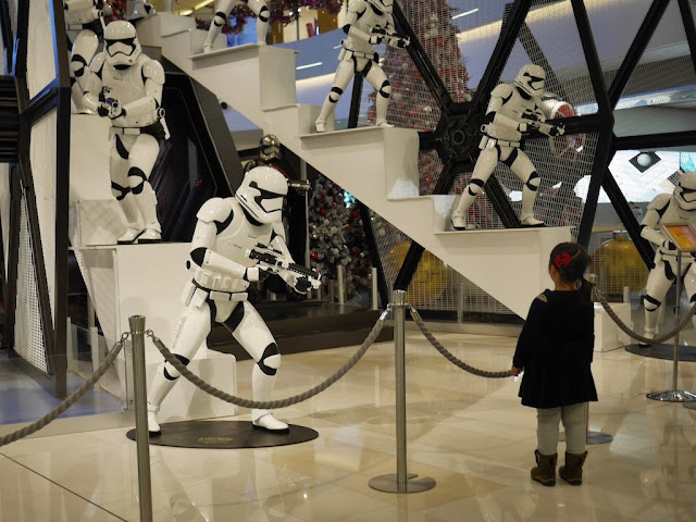little girl looking at a Star Wars display at the IAPM shopping center in Shanghai