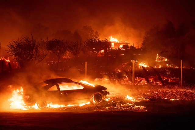 Flames consume the town of Paradise, California. The wildfire killed 86 people. Photo: Josh Edelson / AFP / Getty Images
