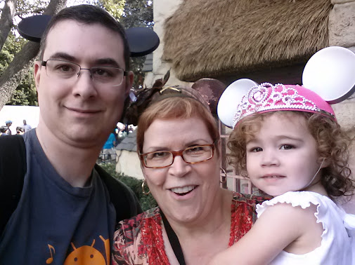 Travis, Grandma, and Phoenix with mouse ears.