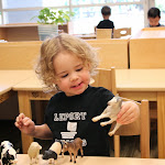 For toddlers, learning about the world starts by naming the things in it. This toddler is learning the names of farm animals. Note that in Montessori, we always use realistic figures, in contrast, for example, to Waldorf, where materials are stylized to the point of no longer being recognizable.