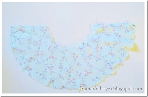 """The cut out piece for the half circle skirt.  There actually two layers of fabric here instead of one because this fabric is very thin.  They will be treated as only one layer, it's cheater method of making a """"lining""""."""