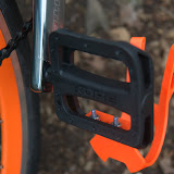 Kore platform pedals from CRC. Orange foot trap from BrickLaneBikes. I had to sand down the little plastic nubs with a dremel for this to attach cleanly.