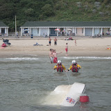 1 September 2012 - the crew members walk out to the upturned motorboat.  Photo credit: Poole RNLI/Dave Riley