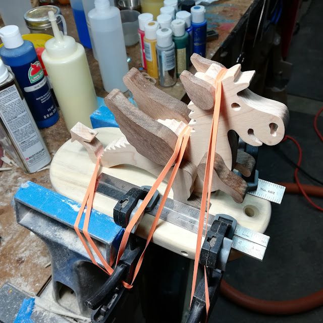 Handmade Wood Toy Dragon Clamped To The Base
