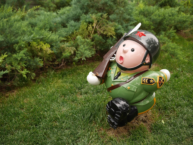 small sculpture of a marching soldier outside the Parkview Green in Beijing