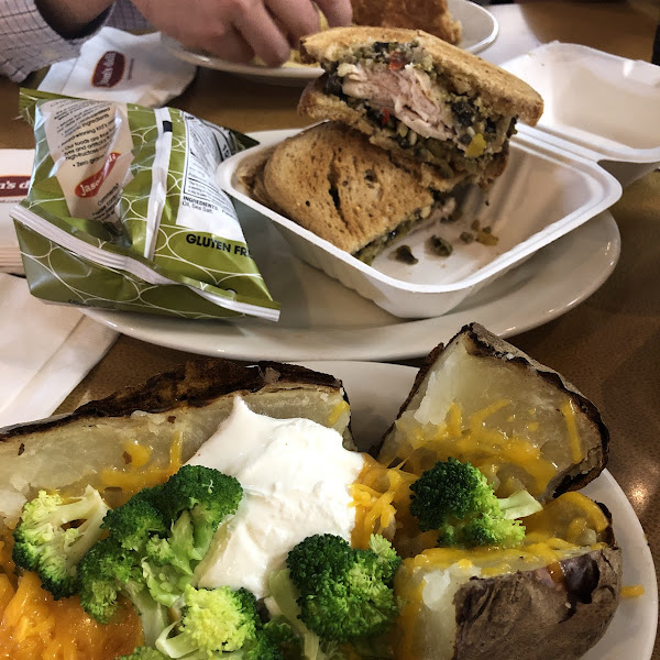 My muffetta on GF bread with a baked potato that has cheese, butter, sour cream, and broccoli as toppings. (The broccoli soup is not GF so this was an alternative suggested by a staff member).