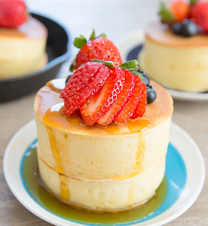 Japanese-style pancakes with maple syrup and fresh strawberries