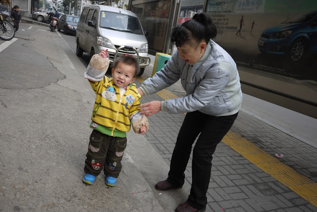 little boy wearing pants with Mario from Mario Bros. in Changsha, China