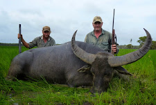 Michael Smallshaw with a great buffalo bull, over 100 SCI. Taken in January during the wet season.
