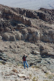 Guy surveying the canyon and valley below.