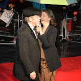WWW.ENTSIMAGES.COM -   John Hurt and Anwen Rees-Myers  arriving at    58th BFI LFF - The Imitation Game - opening film at Odeon Leicester Square, London October 8th 2014A biopic of Alan Turing, which opens this year's BFI London Film Festival.                                                    Photo Mobis Photos/OIC 0203 174 1069
