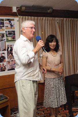 Club President thanking Reiko for her wonderful concert. Club Member, Taka Iida, who kindly oranized for Reiko to play for us is seen here doing a duet with Reiko. Photo courtesy of Dennis Lyons.