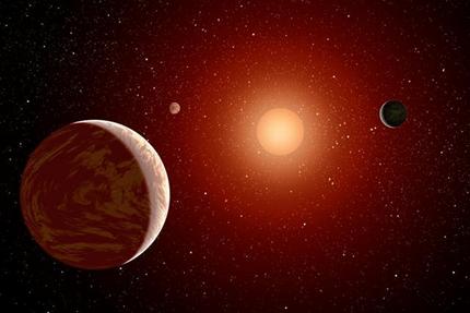 ilustração de três planetas orbitando uma estrela anã vermelha