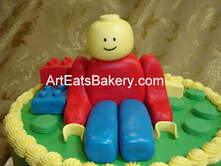 Custom designed lego man boy's green butter cream birthday cake
