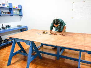 Photo: marking planks on the plywood sheet