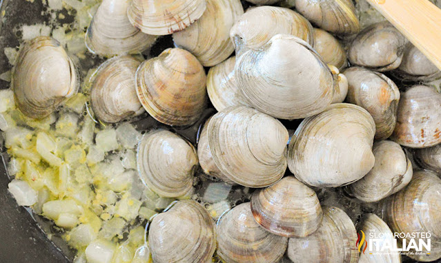 add clams to skillet