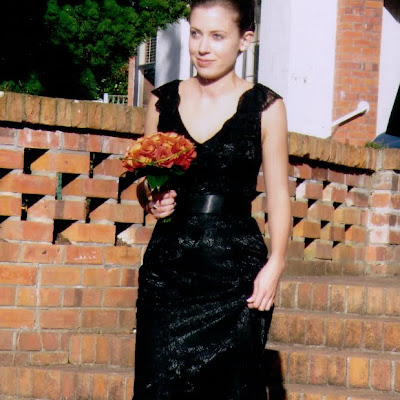 Bronwyn- Black lace gown with neck flounce