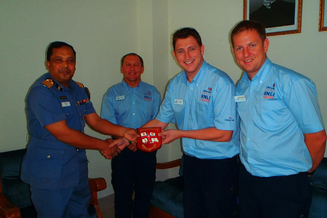 26 October 2012 - handshakes as the RNLI trainers are presented with a crest from the Bangladeshi coastguard.