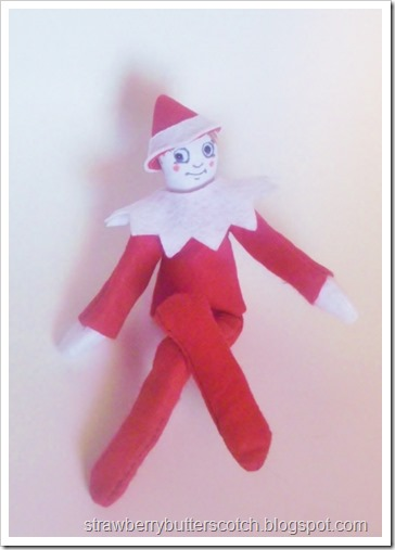 An diy elf on the shelf, now fully dressed.