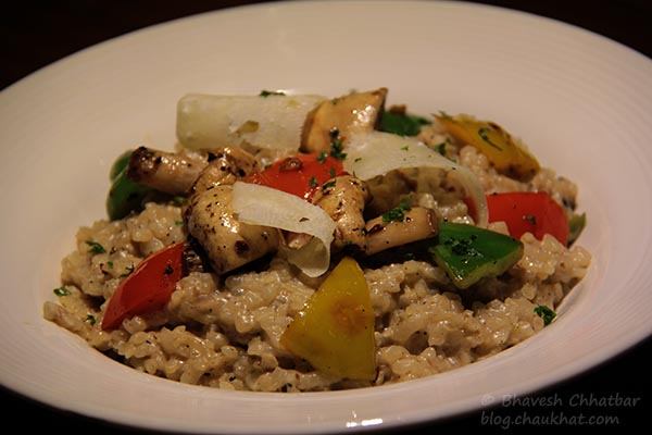 Close-up of La Fungi Risotto with White Wine, served at Toss Sports Lounge Koregaon Park