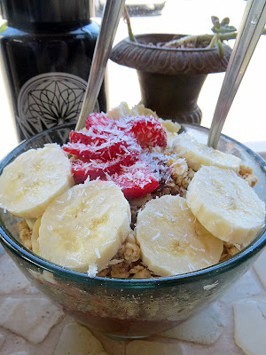 Choice Health Food's Dessert Sunrise Bowl with acai, banana, strawberries, macadamia, cacao, honey, almond milk, and topped with bananas, strawberries, coconut, hemp seeds, and cacao nibs in Lahaina, Maui