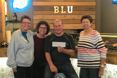 Barry Furuseth, Owner of BLU Fresh Fish Market Place presents a check in the amount of $242.38 for the fundraiser held on April 7, 2017 to BVWGC members Patty Walker, Carol Kaufman and Nan DeLany on April 26, 2017.