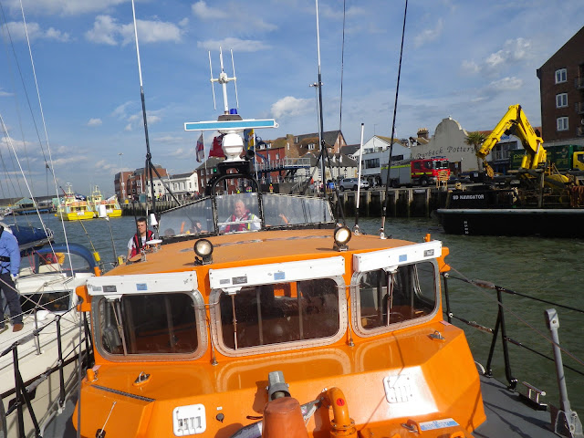 Back alongside Poole Quay with the stricken yacht - 19 May 2014.  Photo credit: RNLI/Poole