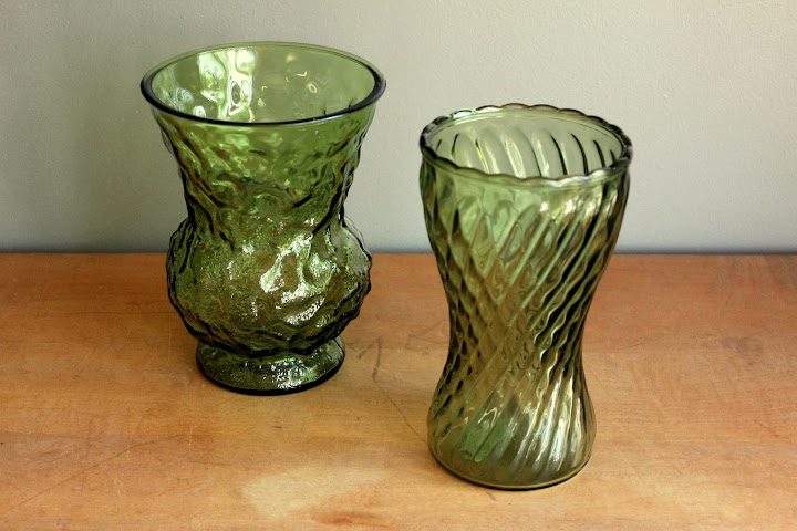 Assorted large green vases available for rent from www.momentarilyyours.com, $2 each.