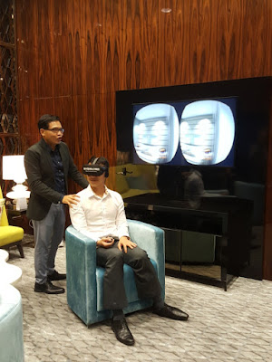 Keppel Land has two virtual reality walkthrough stations with swivel chairs for ease of exploration. Prospective customers can wear the Oculus Rift headset and navigate with the help of a handheld one-button cursor control. The images delivered to the left and right eyes can be viewed on dual screens.