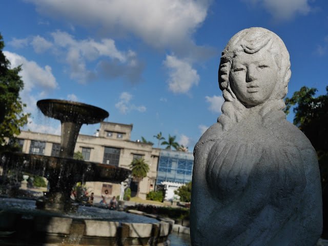 Stature of a woman in front of a fountain at the Songshan Cultural and Creative Park