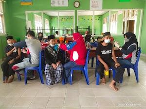 Peringati Hari Santri, Polres Inhil Vaksinasi 322 Santri dan Warga di Kecamatan Keritang