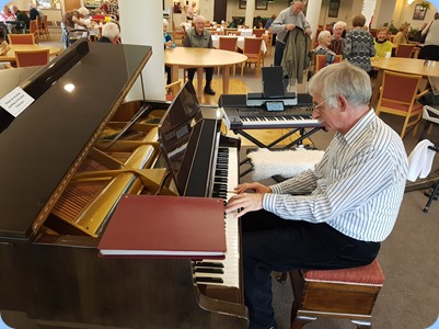 Claude Moffat playing the Schimmel grand piano