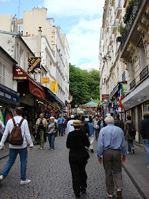 Street leading to Sacre Coeur - Rue Steinkerque.  Cool street with all sorts of little shops. Of course, these shops are just tourist traps, but they're fun to walk through.
