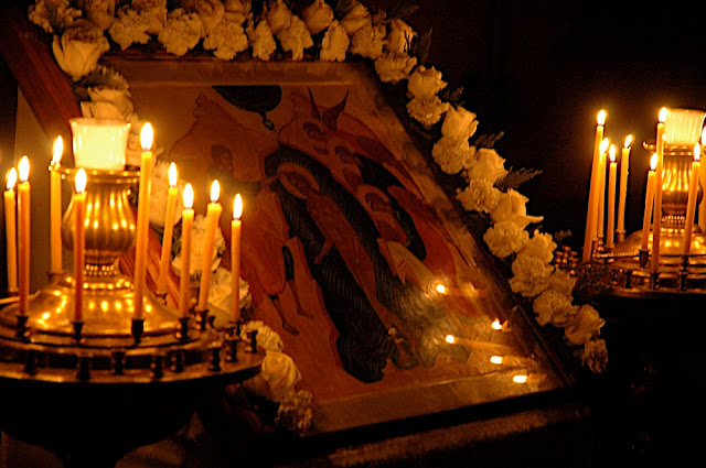 The icon of Holy Theophany - written by Heather MacKean - is adorned with flowers.