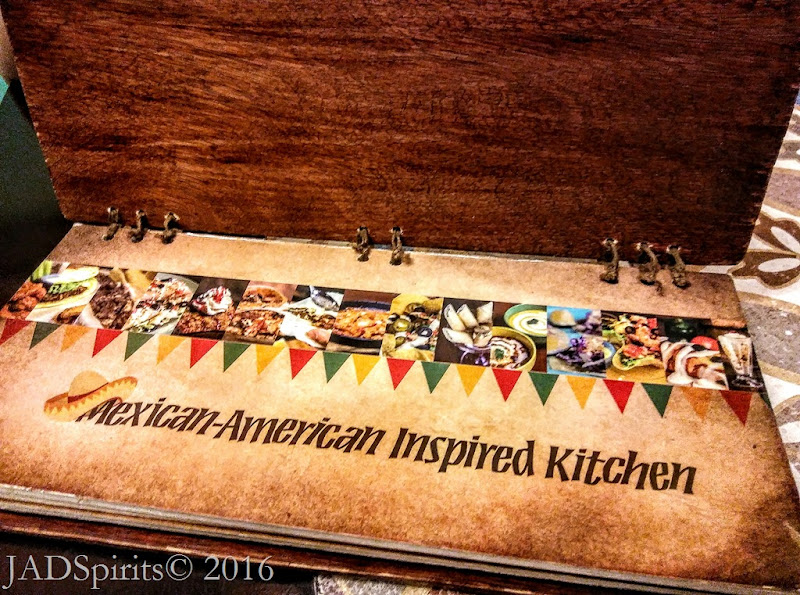 """The first page of the Spanglish Menu with their tagline """"Mexican-Amertican Inspired Kitchen"""""""