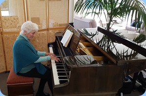Audrey Henden playing the Schimmel mini=grand piano.