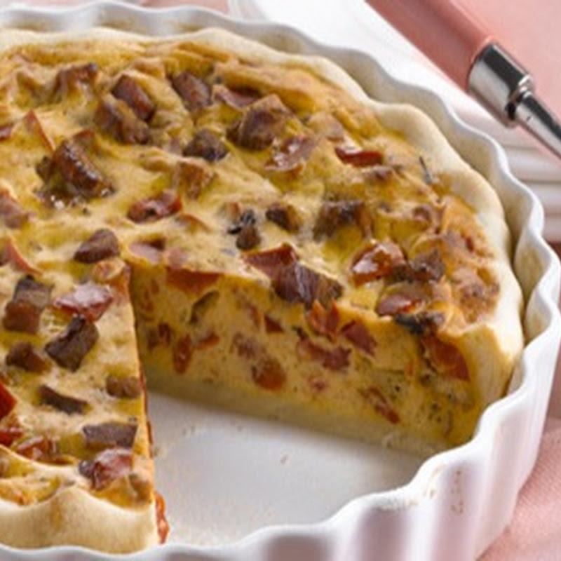 Scopri cosa cucinare a Pasqua: Torta salata ricotta, pancetta e peperoni.
