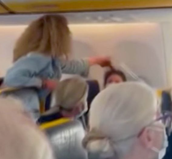 Woman attacks another passenger on flight from Ibiza in violent row over face masks (video)