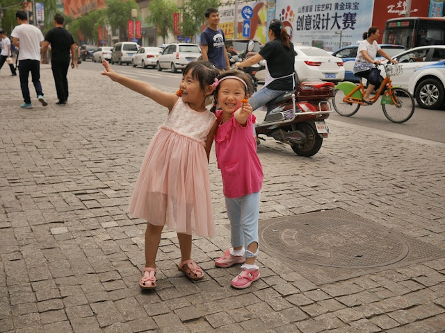 two little girls posing for a photo in Taiyuan, Shanxi