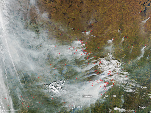 This natural-color image was acquired by the Moderate Resolution Imaging Spectroradiometer (MODIS) on NASA's Terra satellite on 15 September 2016. Red outlines show warm land surface temperatures—a sign of fire. Smoke plumes to the lower right indicate burning north of Ust'-Kut, Russia, which also saw wildfires earlier in 2016. On 9 September 2016, dense smoke covered the Siberian city of Bratsk, Russian media reported. Photo: Jeff Schmaltz / LANCE/EOSDIS Rapid Response