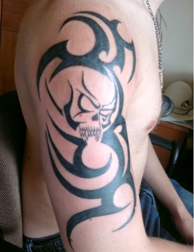 tribal skull tattoos designs on arms