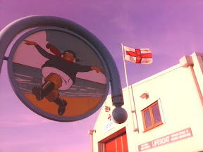 Skegness Jolly Fisherman sign with Lifeboat station flying RNLI flag