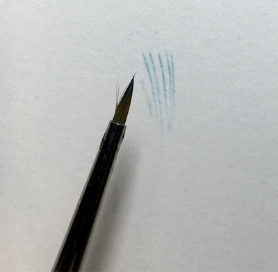 splayed hairs on a winsor and newton paint brush