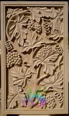 Relief ukiran batu alam untuk dinding