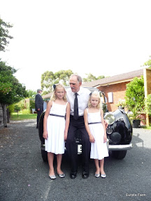 Dad with Sarah and Hannah in front of the Bentley